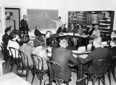This is a photo of a staff meeting, ca. 1967